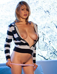 Dalia dayze busting out of her black and white striped top
