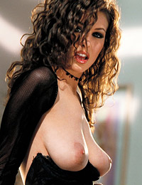 Ginger jolie laying in furs in black top and skirt