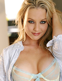 Kayden kross spreads and plays on the living room floor