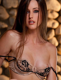Erica ellyson strips by a stone wall