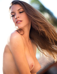 Amber sym takes off her top in warm sunlight